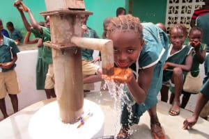 The Water Project: Kamasando DEC Primary School -  Water Flowing