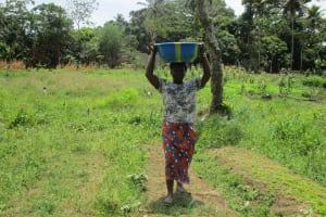 The Water Project: Tholmossor, Amputee Camp -  Carrying Water