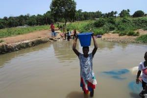 The Water Project: Kasongha, 8 BB Kamara Street -  Carrying Water