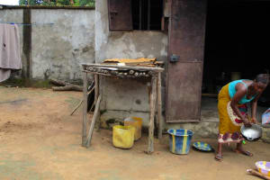 The Water Project: Kasongha, 8 BB Kamara Street -  Dishes Drying Outside Of Kitchen