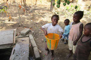 The Water Project: Targrin Health Post -  Fetching Water At Open Well
