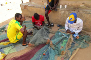 The Water Project: Targrin Health Post -  Fishermen Reparing Their Nets
