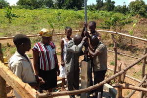 The Water Project: Hamis Water Source Pakanyi Community -  Community Members Contribute To Well Construction