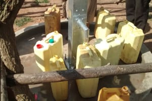 The Water Project: Hamis Water Source Pakanyi Community -  Filling Containers At Well