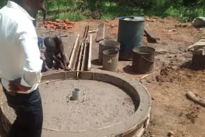 The Water Project: Hamis Water Source Pakanyi Community -  Setting Cement For Well Pad
