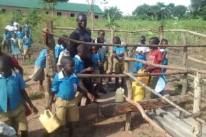 The Water Project: Hamis Water Source Pakanyi Community -  Students Draw Water From Completed Well