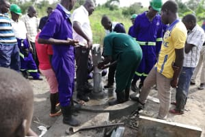 The Water Project: Alimugonza Community A -  Attaching The Pump