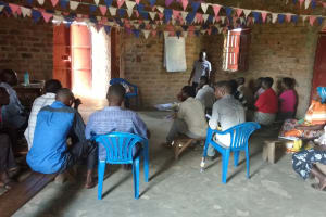 The Water Project: Alimugonza Community A -  Listening During Training Session
