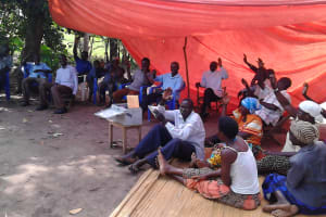 The Water Project: Alimugonza Community A -  People Participate During The Training Session