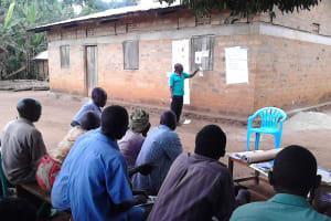The Water Project: Kyamudikya Community A -  Facilitator Leads Community Training