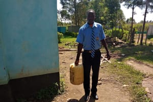 The Water Project: Nambilima Secondary School -  Carrying Water To School Kitchen