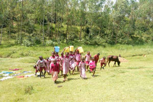 The Water Project: Ivumbu Primary School -  Carrying Water