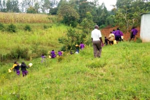 The Water Project: Munyanza Primary School -  Rushing To Fetch Water