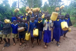 The Water Project: Essongolo Primary School -  Students Walking To Spring