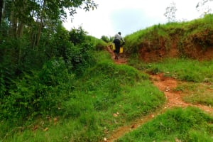 The Water Project: Mukhunya Community, Mwore Spring -  Carrying Water