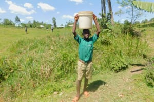 The Water Project: Shinyikha Primary School -  Carrying Water Back To School