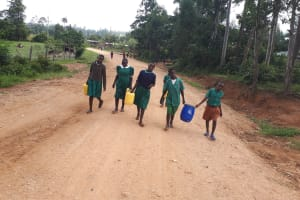 The Water Project: Ebutenje Primary School -  Carrying Water