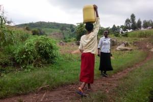 The Water Project: Imbinga Community, Arunga Spring -  Carrying Water