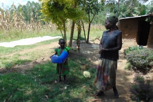 The Water Project: Emukangu Community, Okhaso Spring -  Water Containers