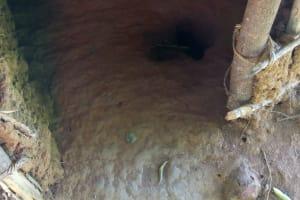 The Water Project: Sichinji Community, Kubai Spring -  Dangerous Mud Latrine Floor