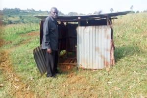The Water Project: Imbinga Community, Arunga Spring -  Festus Showing Us The Family Latrine