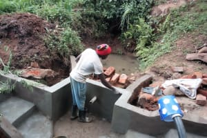 The Water Project: Samisbei Community, Isaac Rutoh Spring -  Spring Construction
