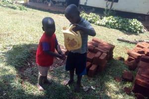 The Water Project: Asimuli Community, John Omusembi Spring -  Handwashing With Leaky Tin