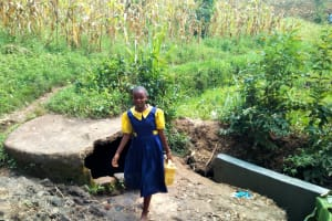 The Water Project: Ibwali Primary School -  Student At Water Source