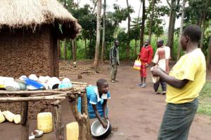 The Water Project: Burachu B Community, Namukhuvichi Spring -  Woman And Child Washing Dishes