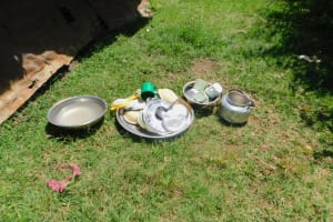The Water Project: Shinyikha Primary School -  Dishes Drying On Ground