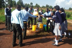 The Water Project: Immaculate Heart Secondary School -  Getting Water From The Well