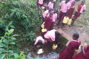 The Water Project: Kitumba Primary School -  Fetching Water