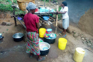 The Water Project: Shisere Community, Richard Okanga Spring -  Women Washing Utensils