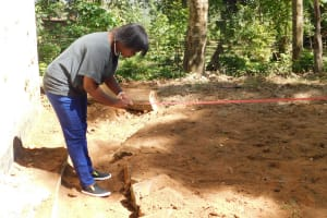 The Water Project: Eshisenye Primary School -  Measuring For Tank Foundation