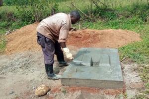 The Water Project: Shirugu Community, Jeremiah Mashele Spring -  Sanitation Platform Construction