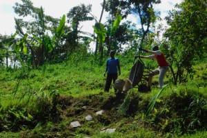 The Water Project: Koloch Community, Solomon Pendi Spring -  Delivering Stones