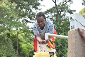 The Water Project: Ilinge Community E -  Water Flowing
