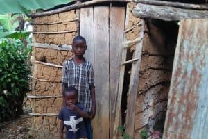 The Water Project: Shihungu Community, Shihungu Spring -  Showing Us The Family Latrine