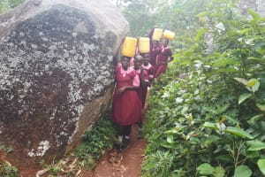 The Water Project: Kitumba Primary School -  Carrying Water Back