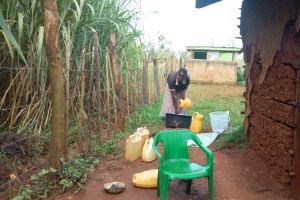 The Water Project: Munyanza Primary School -  School Staff Washing Utensils