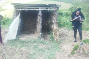 The Water Project: Emukangu Community, Okhaso Spring -  Staff Recording Information