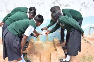 The Water Project: Ngaa Secondary School -  Water Flowing