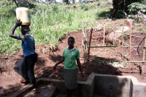 The Water Project: Samisbei Community, Isaac Rutoh Spring -  Flowing Water