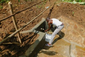 The Water Project: Koitabut Community, Henry Kichwen Spring -  Flowing Water
