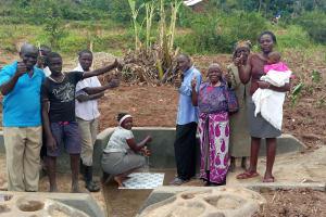 The Water Project: Shirugu Community, Jeremiah Mashele Spring -  Flowing Water