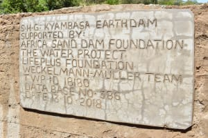 The Water Project: Mbakoni Community -  Sand Dam Plaque