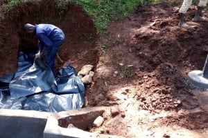The Water Project: Chepnonochi Community, Chepnonochi Spring -  Protecting Behind The Discharge Pipe