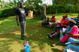 The Water Project: Koitabut Community, Henry Kichwen Spring -  Leaky Tin Handwashing Station
