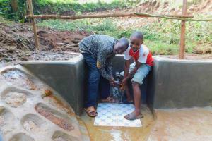 The Water Project: Koloch Community, Solomon Pendi Spring -  Water Flowing