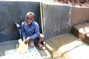 The Water Project: Chepnonochi Community, Chepnonochi Spring -  Flowing Water